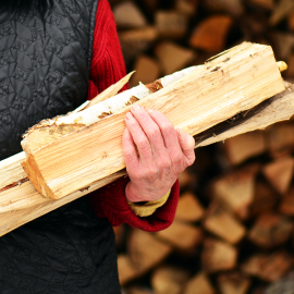 Close Up of Person Holding Firewood